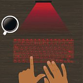Laser virtual Keyboard with the projection on a wooden surface.