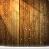 Light on blank wooden background with falling Snow