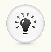 Lightbulb icon on white round vector button