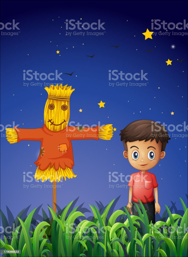 Little boy standing beside the scarecrow royalty-free stock vector art
