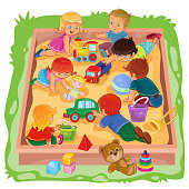 Little boys and girls sitting in the sandbox, play their