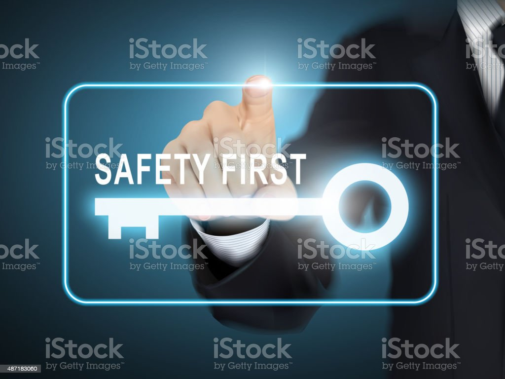 male hand pressing safety first key button vector art illustration