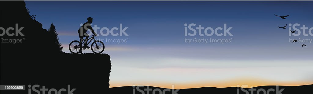 Mountain Biker on Cliff at Sunset royalty-free stock vector art