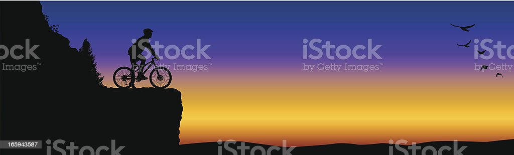 Mountain Biker on Cliff at Sunset royalty-free stock vector art