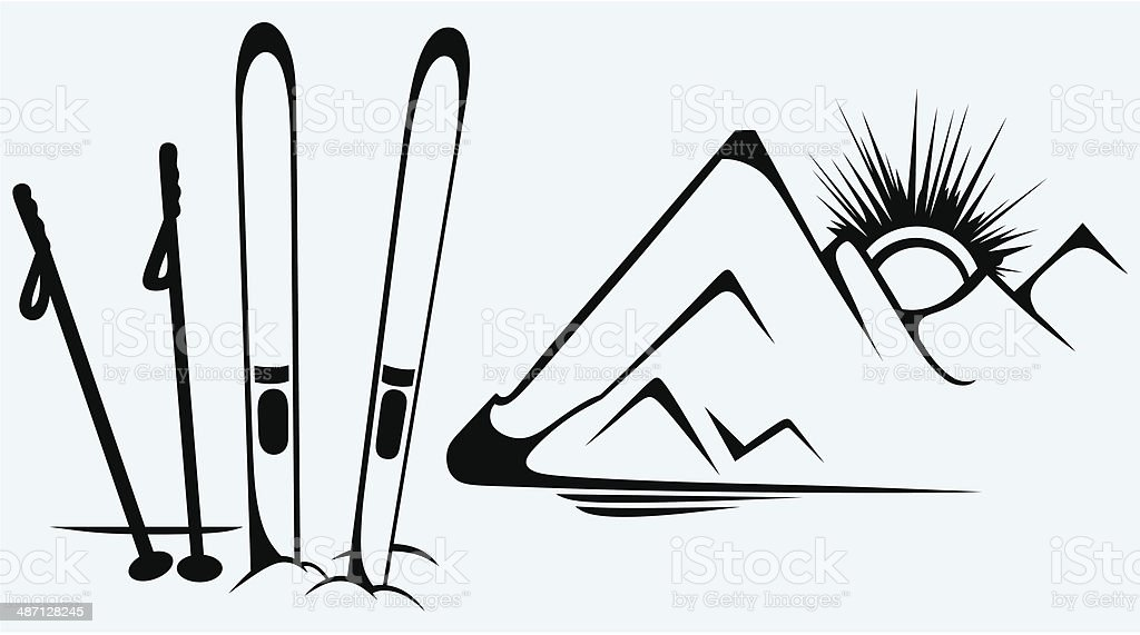 Mountains and ski equipments vector art illustration
