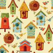 Multi-colored birdhouses and birds. Seamless background pattern.