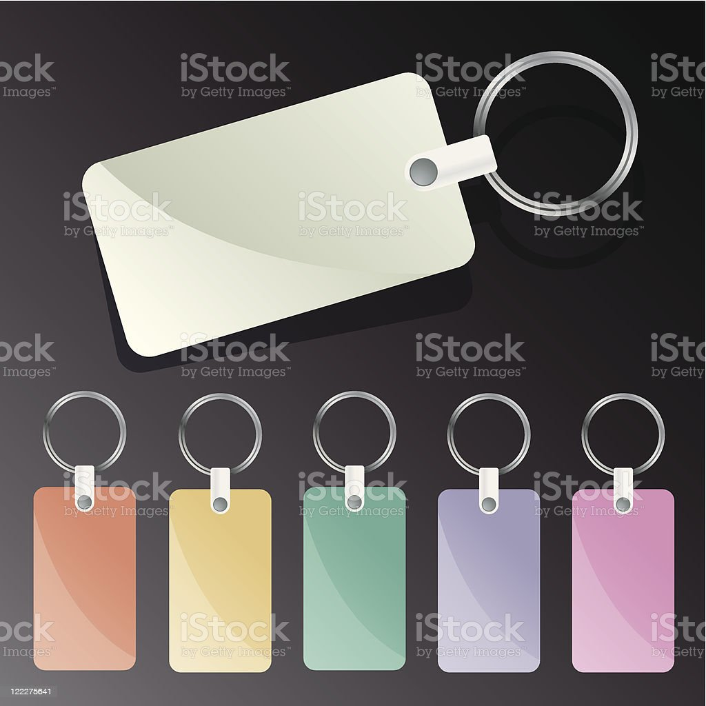Multicolored blank keychain tags on black background vector art illustration