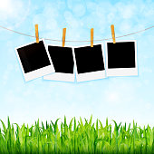 Nature background with green grass and photos on rope vector