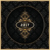 New Year 2017 greeting card with gold ornaments. Vector.