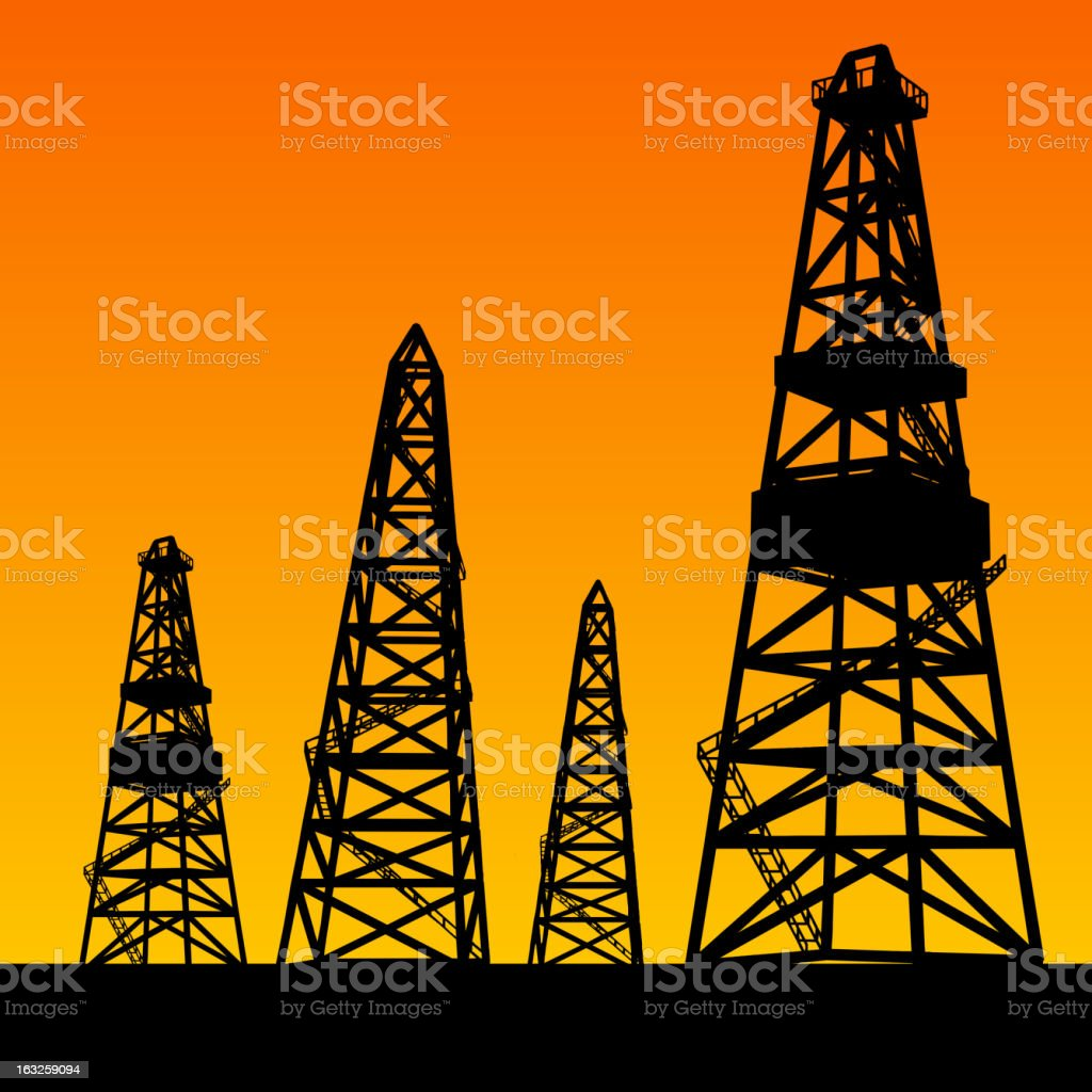 Oil rig silhouettes and orange sky royalty-free stock vector art