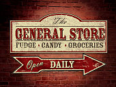 Old fashioned wooden General Store signage on brick wall