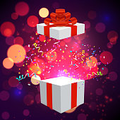 Open Xmas box with confetti on bokeh background. Vector