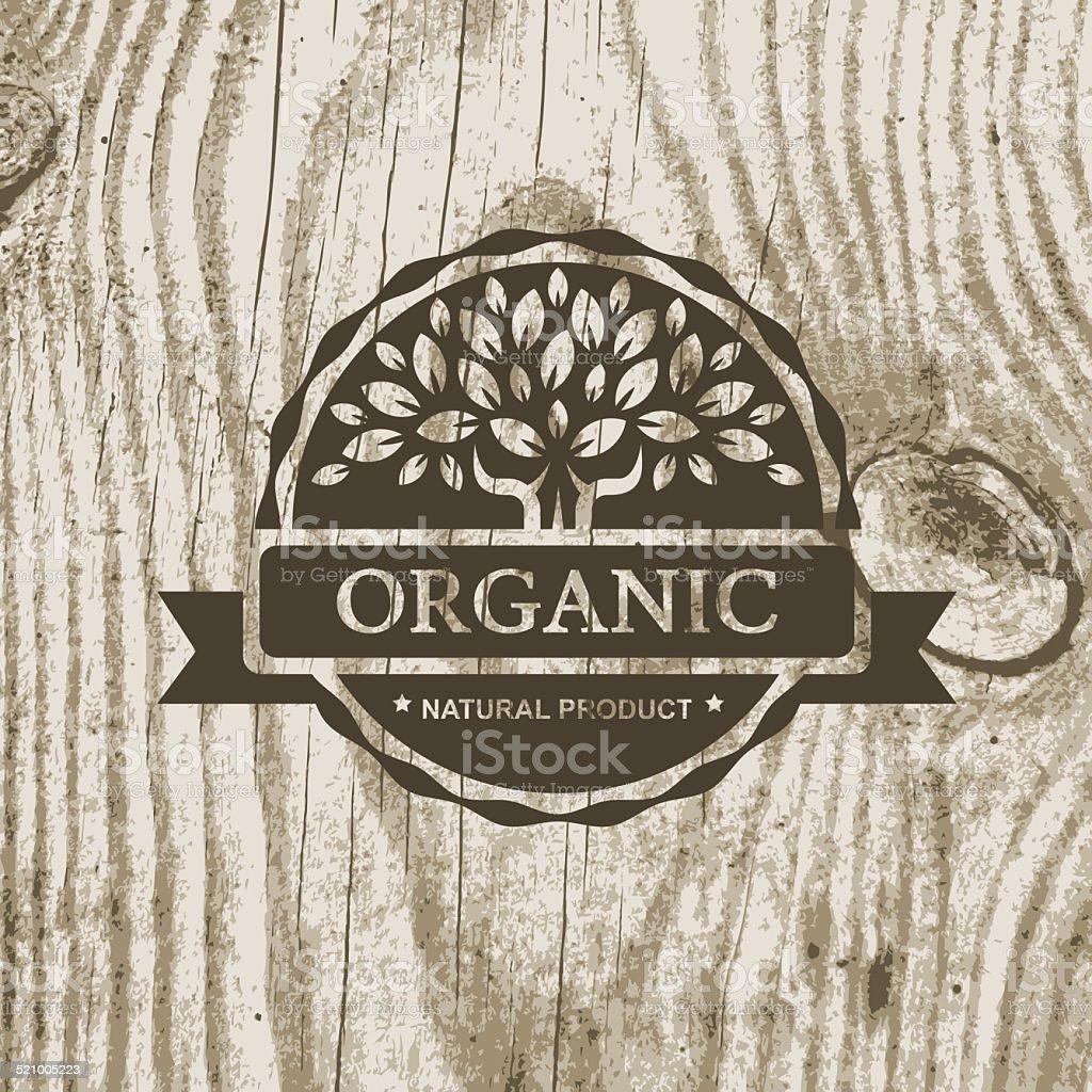 Organic product badge with tree on wooden texture. Vector illust vector art illustration