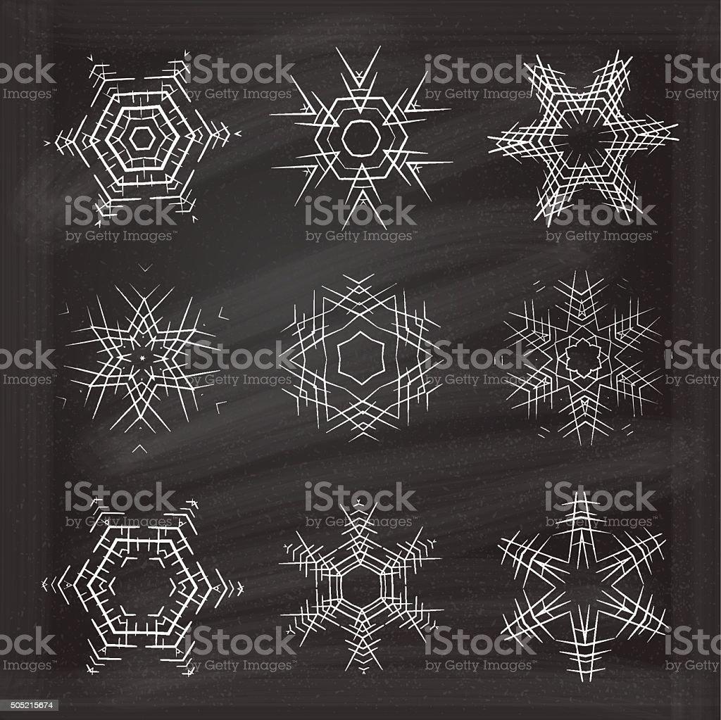 Ornamental snowflakes set on chalkboard background. vector art illustration