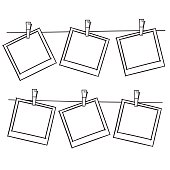 Photo frames on rope.