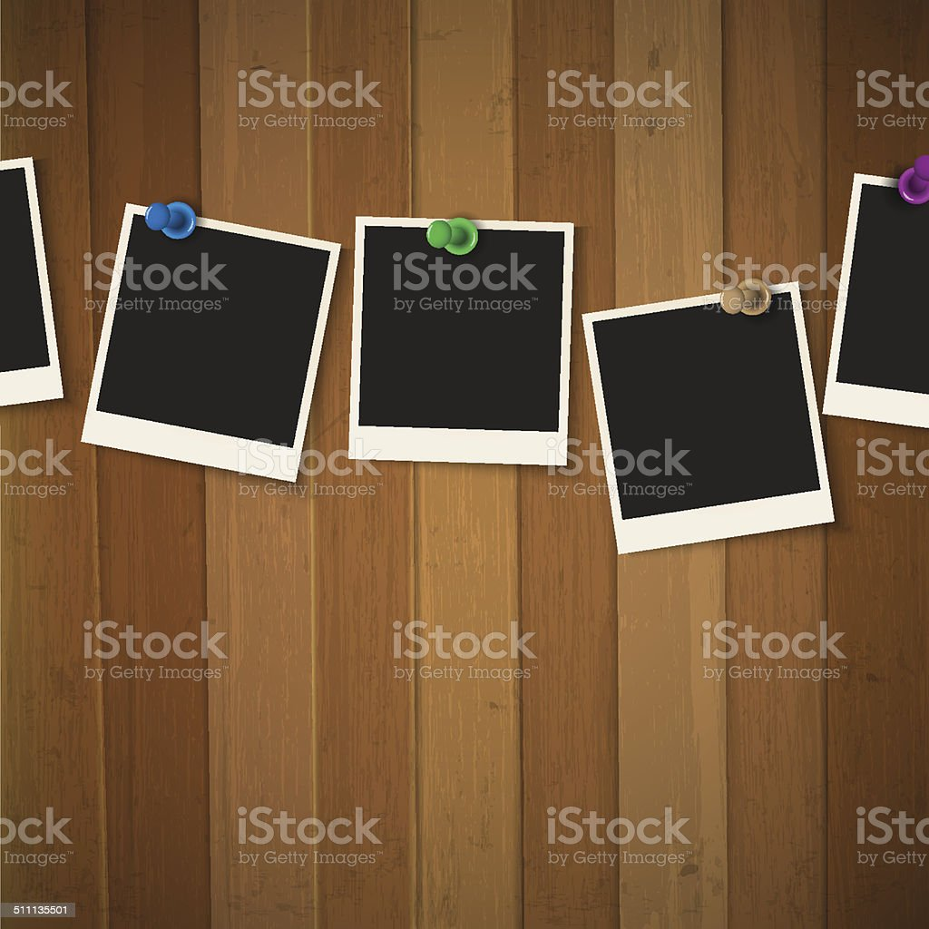 Photo frames with colored pushpins on wooden background vector art illustration