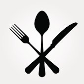 A picture of a black spoon for and knife