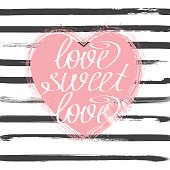 Pink hand drawn heart with calligpraphy text on grey stripes