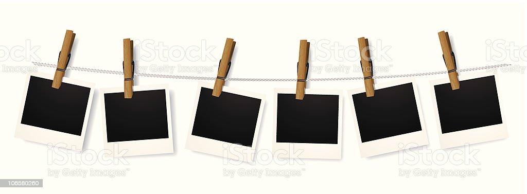 Polaroids hanging on clothes line vector art illustration