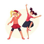 Portrait of teenaged two girls in pink clothes dancing