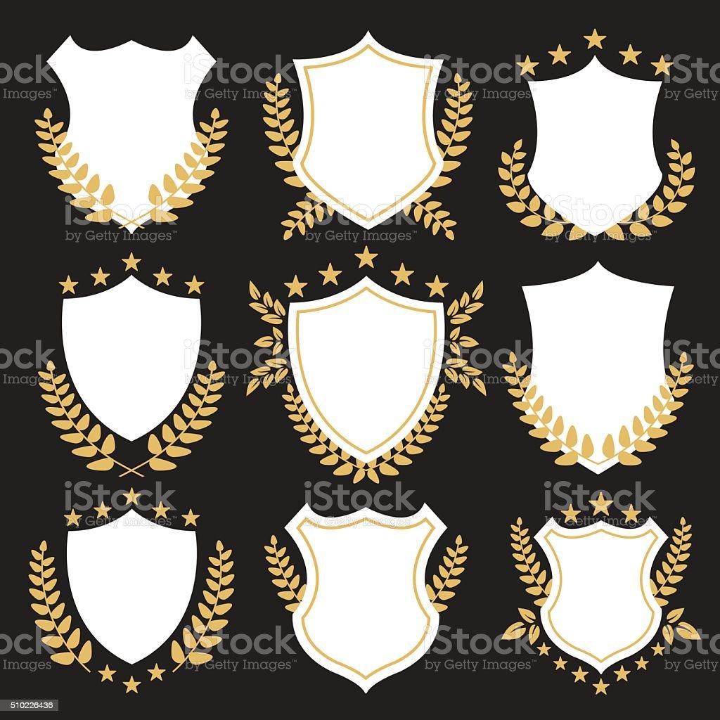 Premium shields and badges set. Shields set with laurel wreaths vector art illustration
