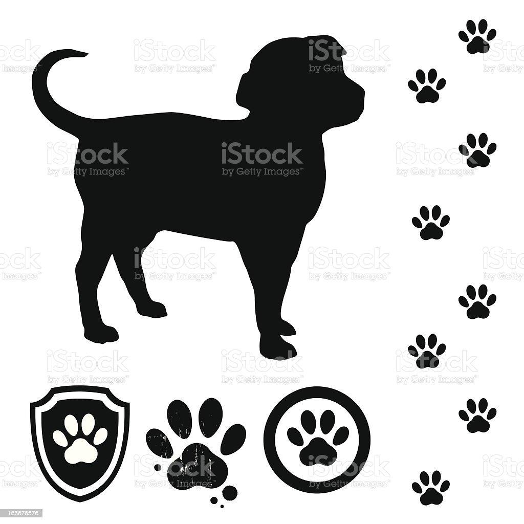 Puppy and tracks vector art illustration