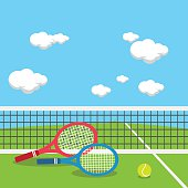 Rackets and tennis ball at tennis court