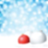 Red and white Christmas baubles blurred