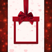 Red banner with  ribbon and bow in form of gift.