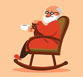 Relaxed old man sitting in rocking chair and drinking tea