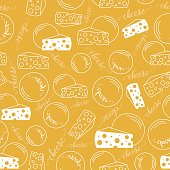Seamless pattern 'Pieces and rounds of cheese lines