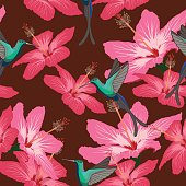 Seamless pattern with hibiscus flowers and hummingbird on maroon