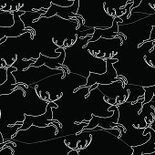 Seamless pattern with silhouette Christmas deer and black hills.