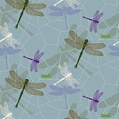 Semless pattern with green and purple dragonflies
