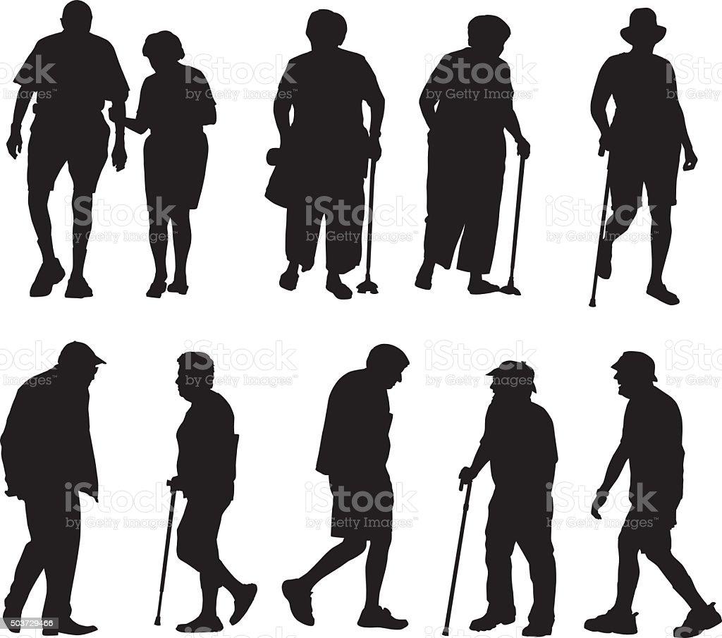 Seniors Walking Silhouettes vector art illustration