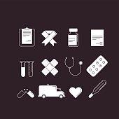 Set of 12 cartoon-style medical icons white on black