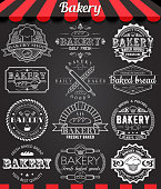 Set of retro bakery logo badges and labels on blackboard