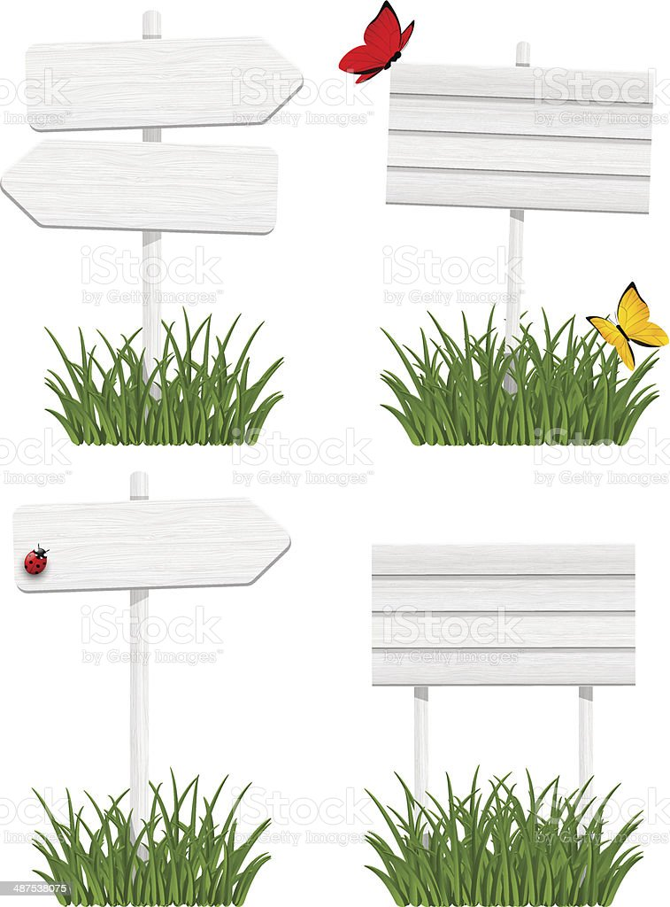 Set of wooden signboards in green grass vector art illustration