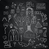 Set wedding symbols and signs on chalk board