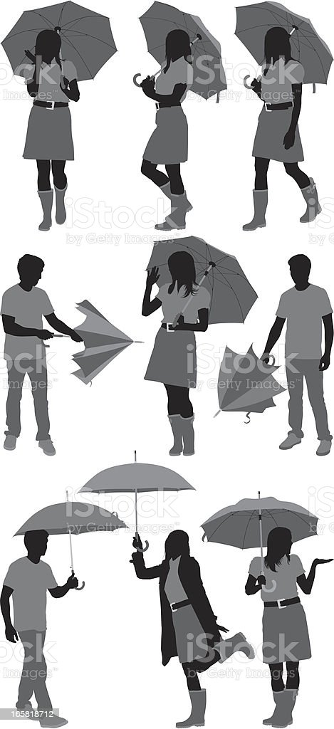 Sihouette of people with umbrellas royalty-free stock vector art