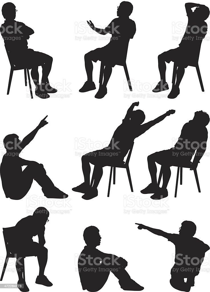 Silhouette males sitting vector art illustration