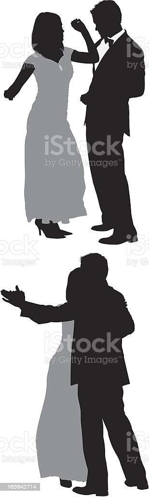 Silhouette of a romantic couple dancing royalty-free stock vector art