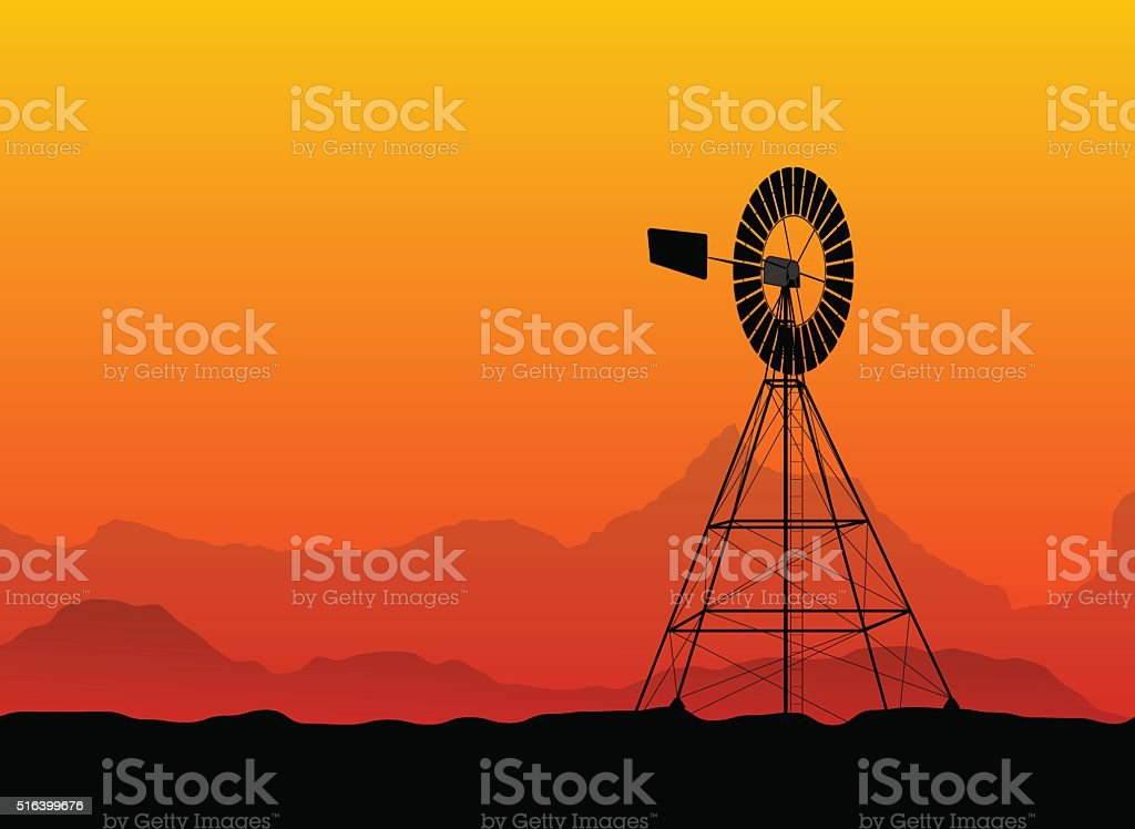 silhouette of a water pumping windmill at the desert vector art illustration