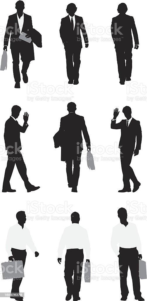 Silhouette of businessmen walking royalty-free stock vector art