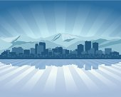 Silhouette of city skyline in shades of blue