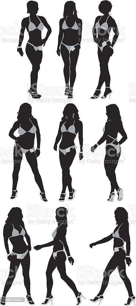 Silhouette of female body builders vector art illustration