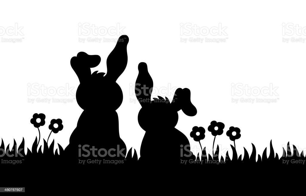 Silhouette of two rabbits on meadow vector art illustration