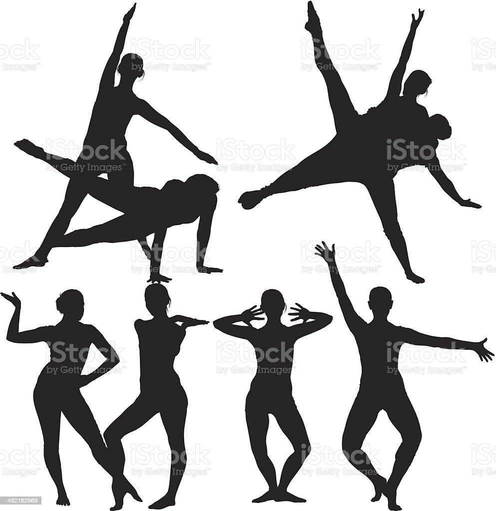 Silhouette of women dancing royalty-free stock vector art