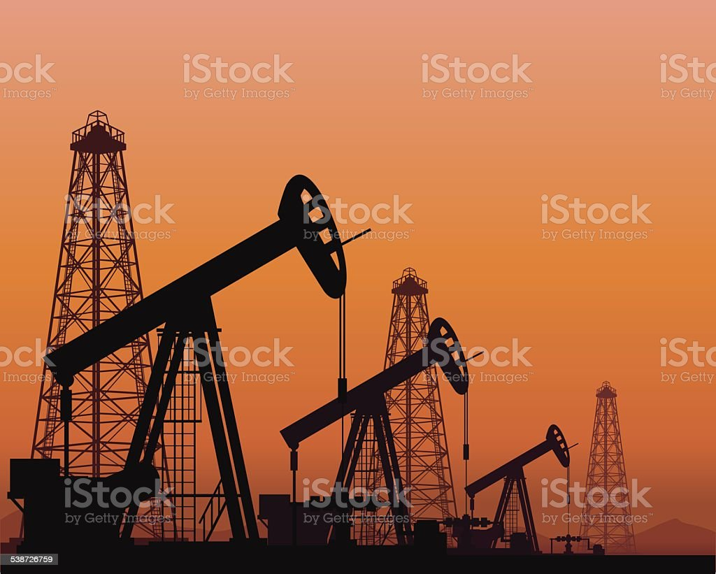 silhouette of working oil pumps on sunset background vector art illustration