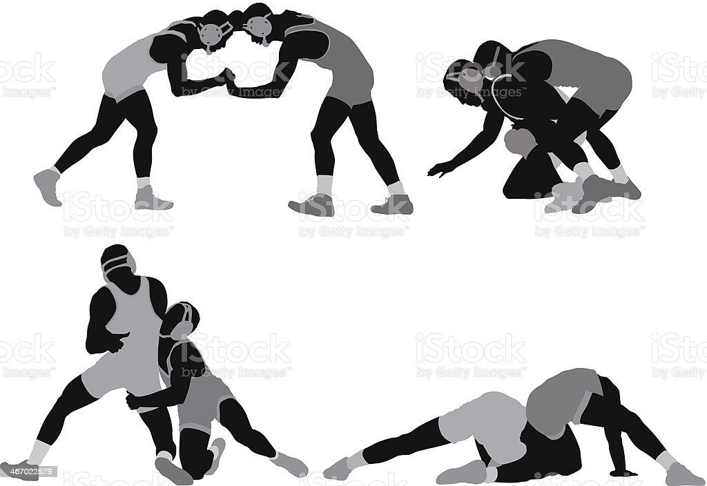 Silhouette of wrestlers in action vector art illustration